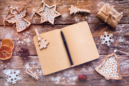 Christmas wish list on a wooden background and Christmas decorations
