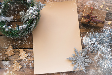 empty Christmas letter on wooden background with bokeh and snow mockup