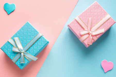 gift for him and her on Valentines Day on a pink-blue background