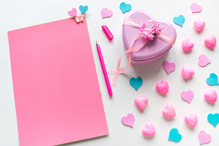 a blank page with space for text and a heart-shaped gift for Valentines Day Stock Photo