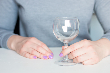 young woman and empty wine glass Stockfoto