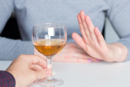 man offer alcohol but woman refuses Stock fotó