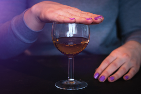 young woman refuses to drink alcohol