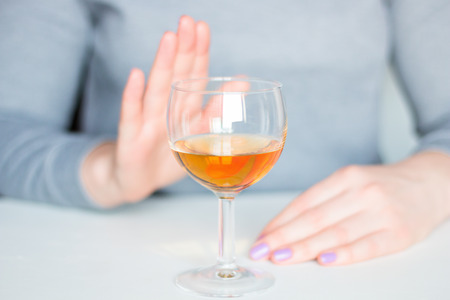 young woman refuses alcohol