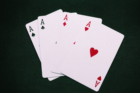 four aces on a green background closeup