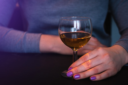 young woman and a glass with alcohol Stock fotó