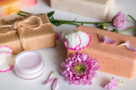 natural handmade cosmetics. soap and spa face cream from herbs and flowers on white background 写真素材