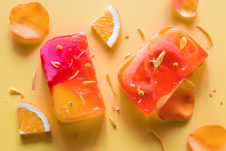 homemade natural soap on a yellow background with flower petals 写真素材