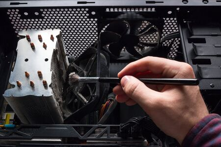 specialist cleans the computer hardware
