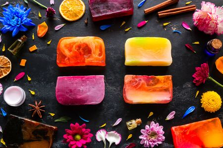 handmade soap, natural cosmetics and herbs on a black background 写真素材