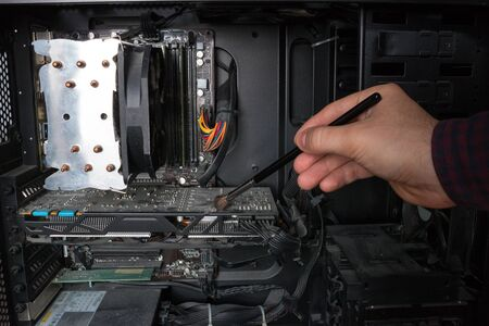 electronic computer technology engineer cleans the PC hardware from dust