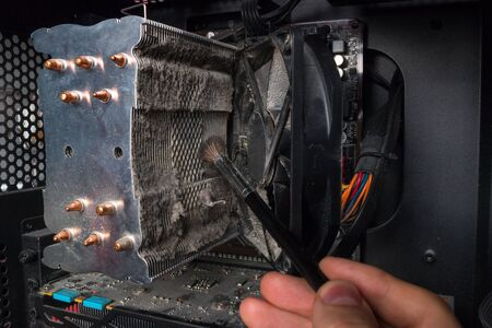 specialist cleans the computers CPU radiator 写真素材