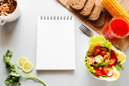 vegetables and notebook with place for text concept diet, diet food Foto de archivo - 131827259