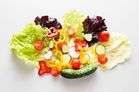 sliced vegetables on lettuce concept vegetarian food, diet Foto de archivo - 131827818