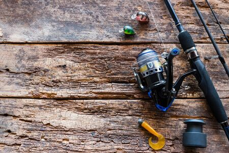 Kurgan, Russia-June 19, 2019 spinning and fishing lures on a wooden background with space for text Foto de archivo - 131825322