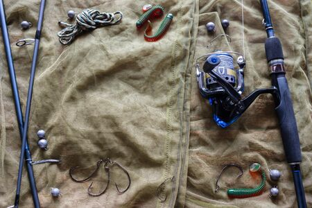 fishing tackle and lures on a grid background with space for text Foto de archivo - 133335555