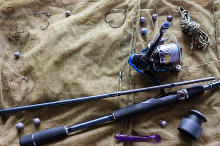 fishing tackle and bait on the background of the grid Foto de archivo - 131827366