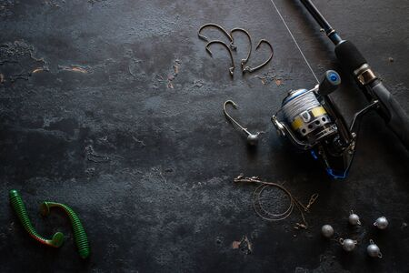 fishing gear and space for text on a black background Foto de archivo - 131826462