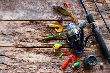 Kurgan, Russia-June 19, 2019 fishing tackle, bait, spinning on a wooden background Banque d'images