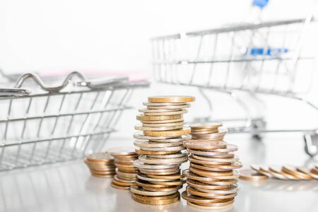 coins and food carts concept inflation, rise in price, poverty