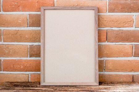empty photo frame on brick background mockup Stock Photo