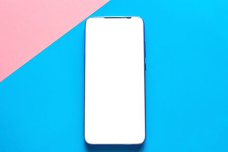 mobile phone on a colored background with a white blank screen. smartphone with place for text mockup Stock Photo