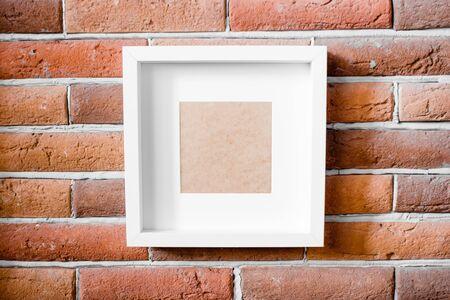 white photo frame on brick background mockup template