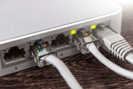 close-up internet router with internet cable