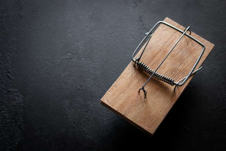 wooden mousetrap on a black background with place for text Zdjęcie Seryjne