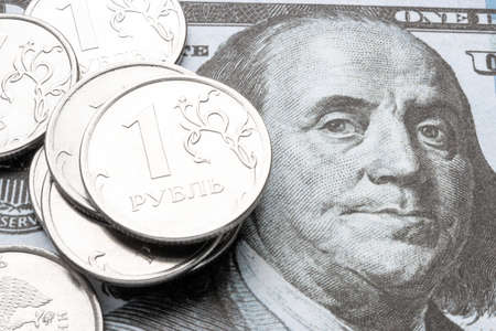 dollar bill and russian ruble close-up. currency devaluation concept