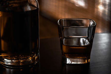 glass and bottle with scotch single malt whiskey