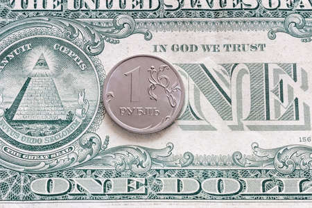 one dollar and ruble close up devaluation concept