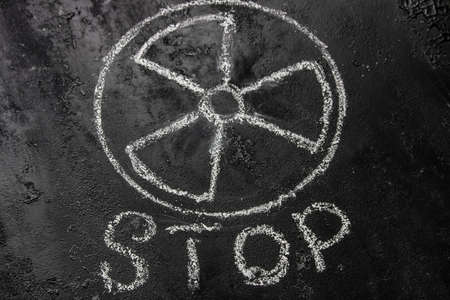 symbol of nuclear weapons and radiation on a black background and the inscription stop. concept refuse Zdjęcie Seryjne