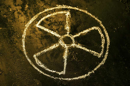 symbol of nuclear weapons and radiation on a black background close up selective focus Stock Photo