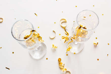 champagne glasses with confetti on a white background christmas concept