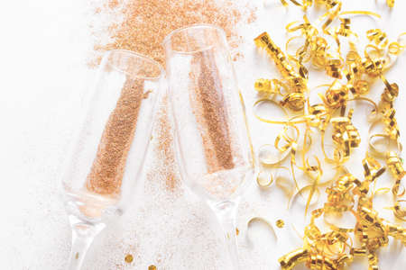champagne glasses with sparkles close-up. holiday christmas concept on a white background