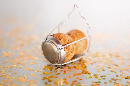cork from champagne and confetti closeup