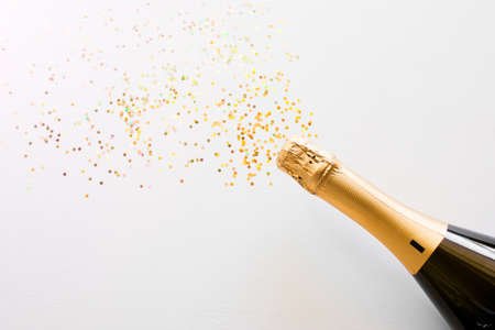 happy new year champagne and confetti bottle concept on white background