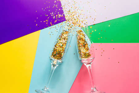 two glasses of champagne with sparkles confetti concept christmas