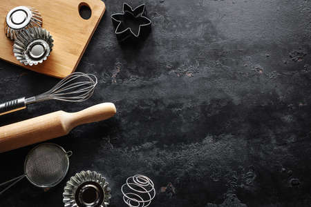 baking dish on black background with place for text