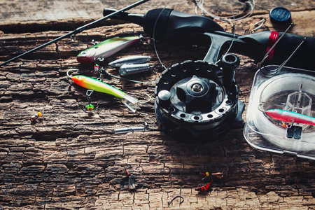 fishing rod and bait for fishing on wooden background Stock Photo