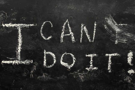 i can do it - chalk lettering on black background close up i can concept