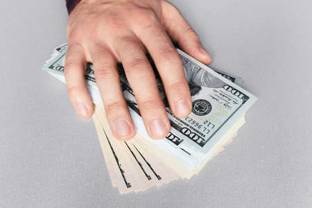 hand and money on the table concept bribe Stock Photo