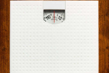 scales close up concept diet weight loss healthy food