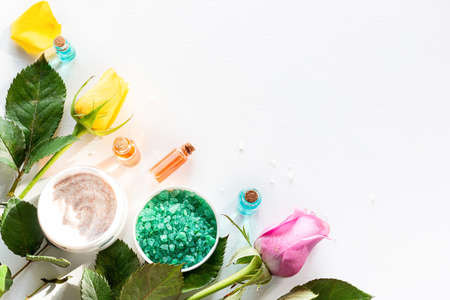 natural cream and oils from herbs and flowers on a white background with place for text