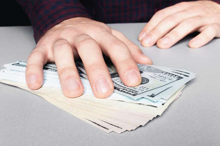taking a bribe with money dollars close-up hand and money Stock Photo