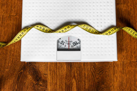 scales and measuring tape concept weight loss diet healthy lifestyle