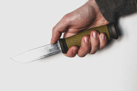 knife in hand close up on white background concept of robber, killer, crime