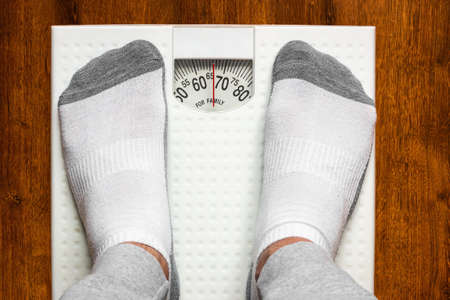 standing on the scales weight loss concept