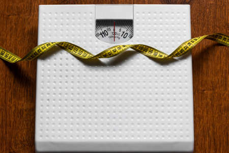 bathroom scales and measuring tape concept weight loss diet healthy lifestyle Stock Photo